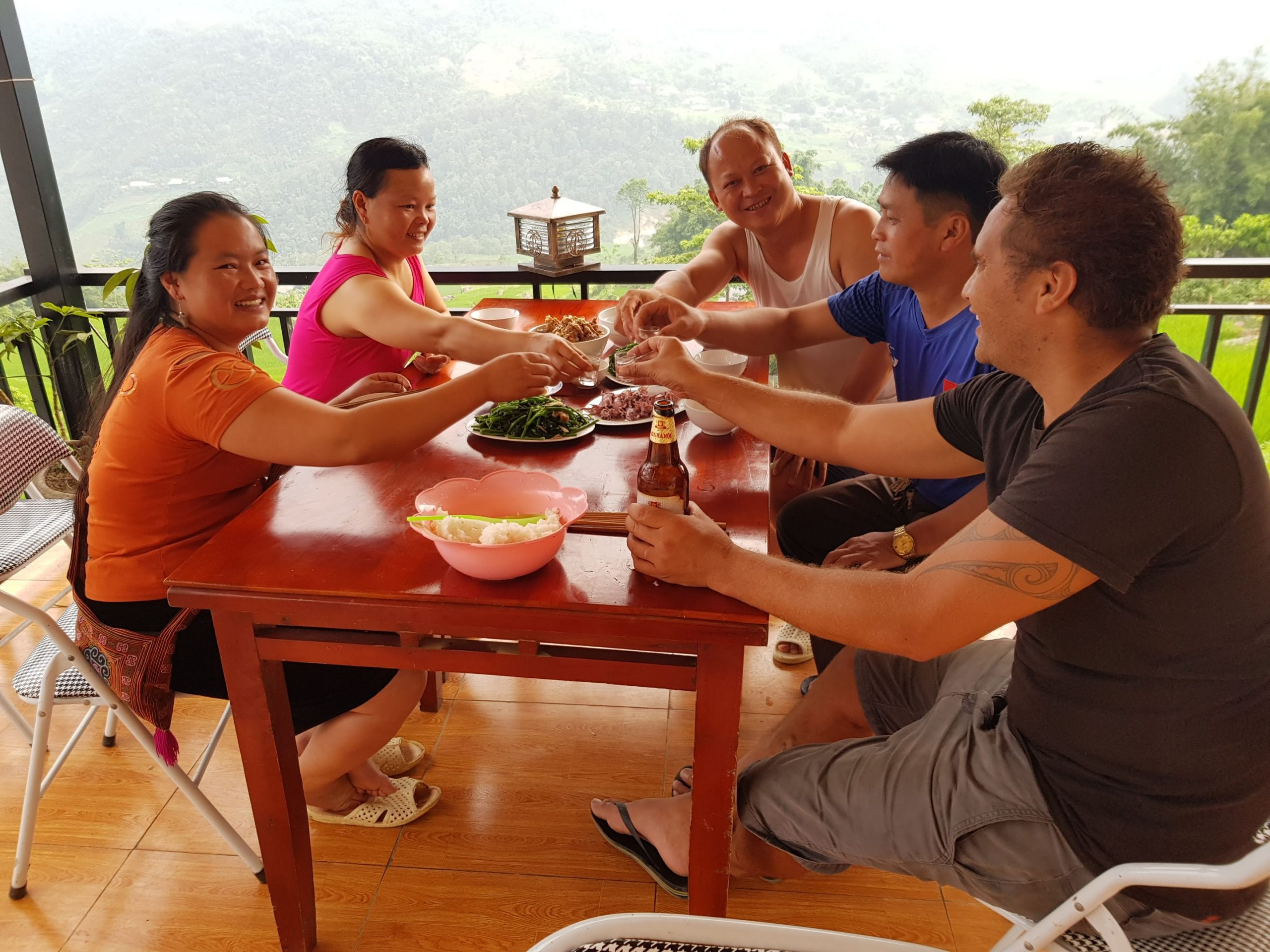 Happy water with the locals - Sapa Family Holiday Recommendations - World Travel Ambitions